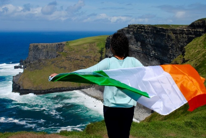 student with Irish flag cape